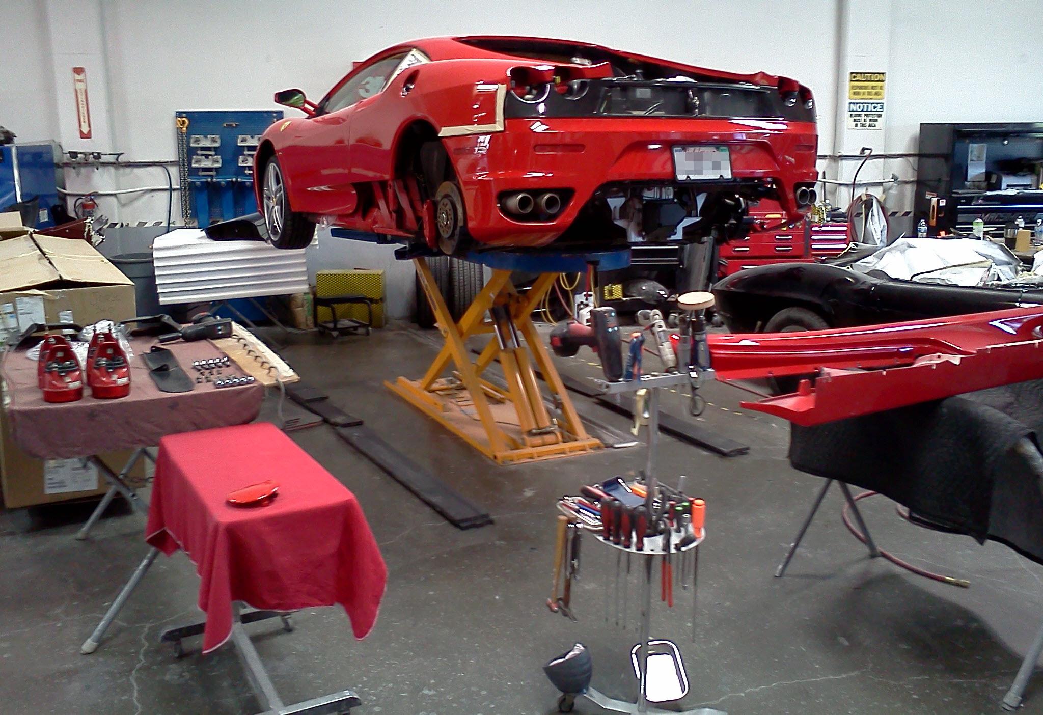Ferrari F430 on repair lift
